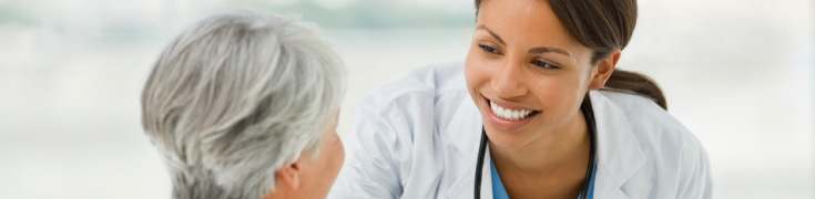 Doctor smiling with a patient