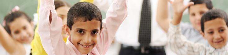Happy child in a school class